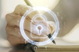 security awareness training feature image of a hand taking notes/writing with a security padlock displayed over it