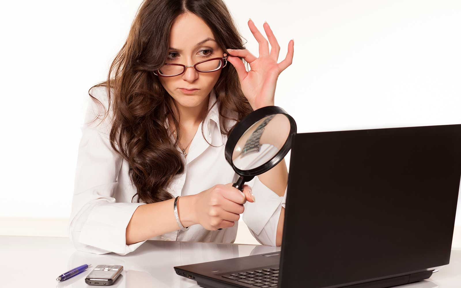 what is typosquatting feature image of a woman inspecting a suspicious website with a magnifying glass