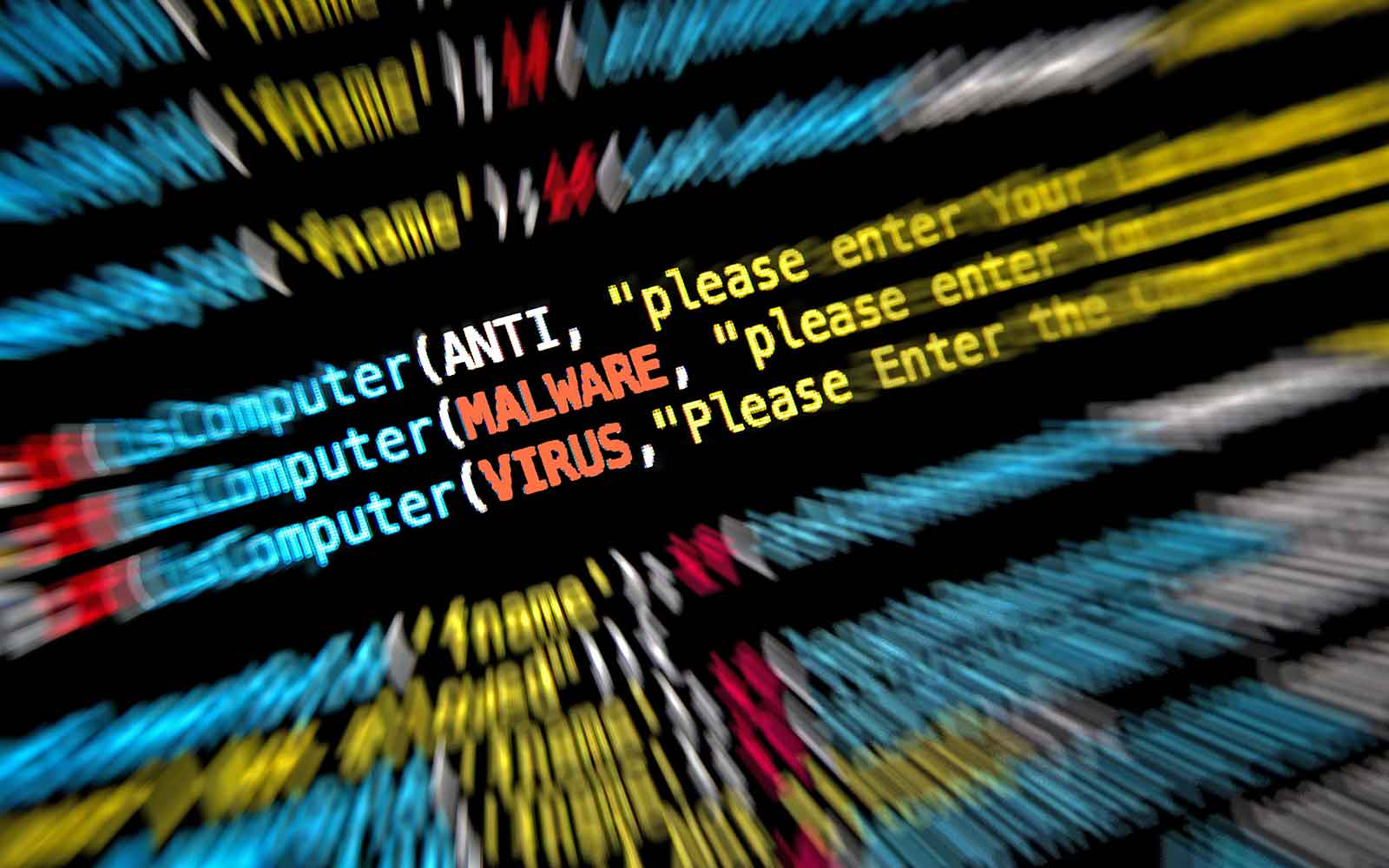 malware vs virus feature image showing a screen of code with those two words highighted