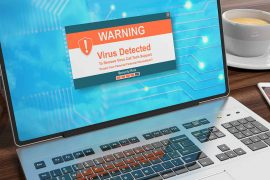 What is a malware attack feature graphic is a picture of a computer displaying a warning message about malware